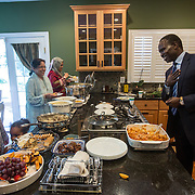 "GREAT FALLS, VA - SEP12: Dr. Mohamed Elsanousi, Director of the Network for Religious and Tradtiional Peacemakers, impresses his friends by speaking Urdu as he celebrates Eid al-Adha, the ""Feast of the Sacrifice"", at an open house September 12, 2016, in Great Falls, Virginia. (Photo by Evelyn Hockstein/For The Washington Post)"