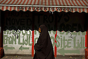 A woman wearing a burkha on Moore Street, Dublin, Ireland.