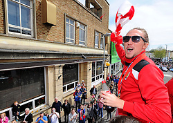 Bristol City's Luke Ayling waves a scarf on the top deck of the open top bus tour  - Photo mandatory by-line: Joe Meredith/JMP - Mobile: 07966 386802 - 04/05/2015 - SPORT - Football - Bristol -  - Bristol City Celebration Tour