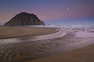 Moonset at dawn over Little Morro Creek and Morro Rock, Morro Strand State Beach, Morro Bay, California