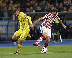 October 9, 2017 - Kiev, Ukraine - Andriy Yarmolenko of Ukraine (L) vies for the ball with Milan Badelj (R) of Croatia during the 2018 FIFA World Cup qualifying soccer match between Ukraine and Croatia at the Olimpiyskyi stadium in Kiev, Ukraine, 09 October 2017  (Credit Image: © Str/NurPhoto via ZUMA Press)