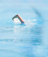 A female swimmer coming towards the camera