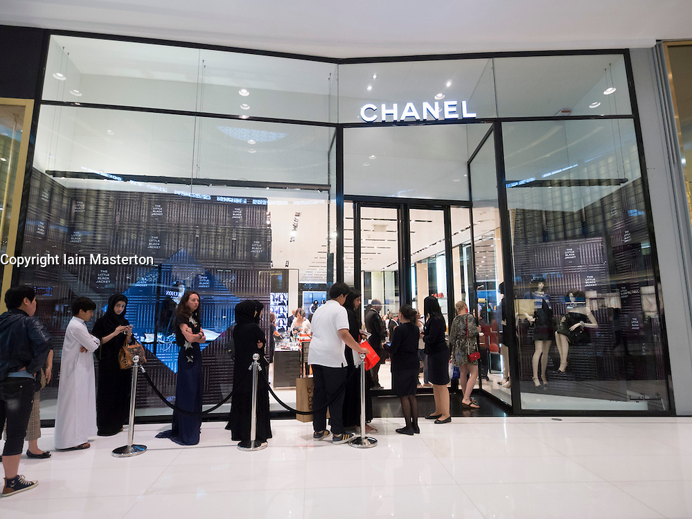 Queue of shoppers outside Chanel boutique at The Dubai Mall in Dubai United Arab Emirates