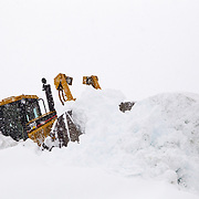 A bulldozer pushes snow in the parking lot of Heather Meadows at Mount Baker Ski Area.