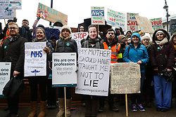© Licensed to London News Pictures. 09/03/2016. Leeds, UK. Protesters and junior doctors demonstrate in the rain and cold outside Leeds General Infirmary in West Yorkshire at the start of 48-hour walkout by junior doctors. This, the longest strike so far, comes after the government announced it would impose the new contracts upon junior doctors after negotiations broke down.  Photo credit : Ian Hinchliffe/LNP