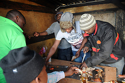 Cape Town-180906 Customers enjoying smiley Sheep head in Khayelitsha. The Sheep head also know as Smiley is very popular in the township it used to be cooked only if there was traditional cremony nowadays there are many places that clean and sell this delicacy,cooked or uncooked Sheep head cost R70 and half R35 Pictures Ayanda Ndamane/African/news/agency ANA