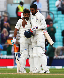 September 11, 2018 - London, England, United Kingdom - L-R Rishabh Pant of India celebrates his first century with Keaton.L.Rahul of India.during International Specsavers Test Series 5th Test match Day Five  between England and India at Kia Oval  Ground, London, England on 11 Sept 2018. (Credit Image: © Action Foto Sport/NurPhoto/ZUMA Press)