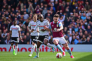 Aston Villa forward Scott Hogan (9) battles with Fulham striker Sone Aluko (24) during the EFL Sky Bet Championship match between Fulham and Aston Villa at Craven Cottage, London, England on 17 April 2017. Photo by Jon Bromley.