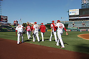ANAHEIM, CA - AUGUST 21:  The Los Angeles Angels of Anaheim relief pitchers walk toward the bullpen before the game against the Cleveland Indians on Wednesday, August 21, 2013 at Angel Stadium in Anaheim, California. The Indians won the game 3-1. (Photo by Paul Spinelli/MLB Photos via Getty Images)