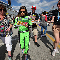Danica Patrick, driver of the #7 GoDaddy Chevrolet signs autographs in the garage area during practice for the 60th Annual NASCAR Daytona 500 auto race at Daytona International Speedway on Friday, February 16, 2018 in Daytona Beach, Florida.  (Alex Menendez via AP)