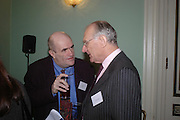 Colm Toibin and Peter Carey. WH Smith Literary Award. Dartmouth House. 14 January 2004. ONE TIME USE ONLY - DO NOT ARCHIVE  © Copyright Photograph by Dafydd Jones 66 Stockwell Park Rd. London SW9 0DA Tel 020 7733 0108 www.dafjones.com