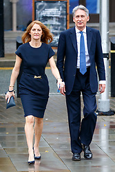 © Licensed to London News Pictures. 07/10/2015. Manchester, UK. Foreign Secretary PHILIP HAMMOND and his wife SUSAN WILLIAMS-WALKER arriving Conservative Party Conference at Manchester Central convention centre on Wednesday, 7 October 2015. Photo credit: Tolga Akmen/LNP