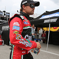 Ricky Stenhouse Jr. walks to his garage area during the first practice session of the 56th Annual NASCAR Coke Zero400 race at Daytona International Speedway on Thursday, July 3, 2014 in Daytona Beach, Florida.  (AP Photo/Alex Menendez)