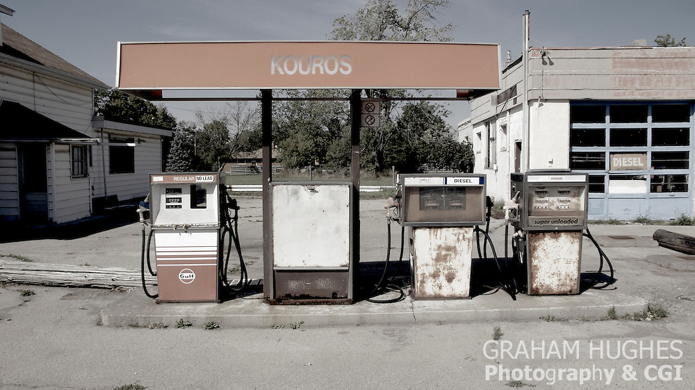 1970's gas pumps at abandoned service station and garage on outskirts of Port Colborne, Ontario, Canada