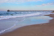 Fishing pier and ocean waves at Atlantic Beach, located along the Crystal Coast of North Carolina (note: fishing pier was damaged by Hurricane Florence less than six months after this scene was photographed)