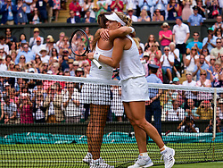 LONDON, ENGLAND - Tuesday, July 10, 2018: Angelique Kerber (GER) (right) embraces Daria Kasatkina (RUS) after her 6-3, 7-5 victory during the Ladies' Singles Quarter-Final match on day eight of the Wimbledon Lawn Tennis Championships at the All England Lawn Tennis and Croquet Club. (Pic by Kirsten Holst/Propaganda)
