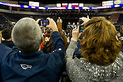 Fans take photos and videos with their phones during Allen High School's football state championship community celebration at the Allen Event Center on Wednesday, January 30, 2013 in Allen, Texas. (Cooper Neill/The Dallas Morning News)