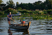 Wooden boats are common modes of transportation near Chau Doc, Vietnam.