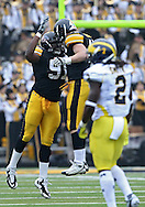 November 05, 2011: Iowa Hawkeyes defensive lineman Broderick Binns (91) and Iowa Hawkeyes linebacker Tyler Nielsen (45) celebrate after a play during the second quarter of the NCAA football game between the Michigan Wolverines and the Iowa Hawkeyes at Kinnick Stadium in Iowa City, Iowa on Saturday, November 5, 2011. Iowa defeated Michigan 24-16.