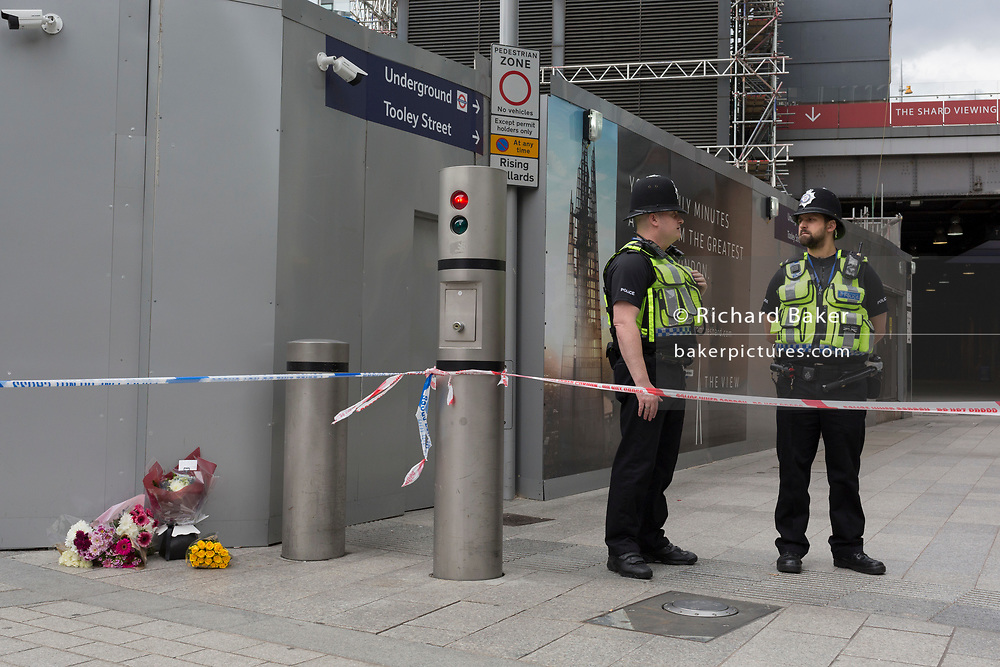 In the aftermath of the London Bridge and Borough Market terrorist attack the previous night, police are positioned at closed road junctions at London Bridge rail station, a half a mile from the crime scene where 7 people were killed and many others injured (Sunday's total). On Sunday 4th June 2017, in the south London borough of Southwark, England. (Photo by Richard Baker / In Pictures via Getty Images)