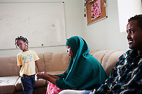 Hal Far, Malta - 20 August, 2012: (R-L) Somali migrant Abdullahi Ali Mohamed (25), his wife Dunia Ahmed Mohamed (29) and their daughter Bofana Mohamed (6) are in a recreational room of the Hal Far Family Center in Hal Far, Malta, on 20 August, 2012. Abdullahi arrived with his family in Malta on May 27, 2012, was held in detention with them for 9 days before being transferred to the family centre. Him and his family left Somalia because of the war on May 25th 2011 and took them about a year to arrive in Malta. They stayed in Libya about 9 months. Though smugglers in Libya ask $900 to each migrant who wants to cross the Mediterrannean Sea to reach Europe, Abdullahi agreed with one smuggler to pay $900 for his entire family, since it's all he had. Abdullahi and his family had one bottle of water for the 37 hours journey from Libya to Malta.<br /> <br /> 1,597 migrants of 30 different nationalities arrived in Malta by boat in 2011. A person arriving in Malta without a valid passport or visa can be detained in terms of immigration law for a period up to 18 months (12 months in case of asylum seekers). Vulnerable individuals can be released early after vulnerability assessment procedures are conducted by the Agency for the Welfare of Asylum Seekers (AWAS).<br /> <br /> <br /> Gianni Cipriano for The New York Times