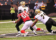 The Atlanta Falcons DE John Abraham (55) slips a through a block by the Saints (t) Jermon Bushrod and sacks New Orleans SAinst QB (9) Drew Brees during the first half of the Saints Falcons game Sunday Sept 26, 2010. The Super Bowl Champions New Orleans Saints play the Atlanta Falcons Sunday Sept 26, 2010 in New Orleans at the Super Dome in Louisiana.  The Saints and Falcons were tied at half time and went into overtime tied 24-24. Hartley missed a kick to win in overtime, the Falcons went on to win in OT with a field goal 27-24. PHOTO©SuziAltman.com