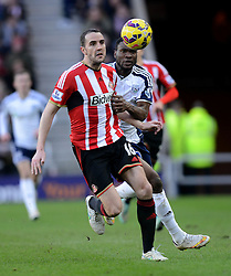 Sunderland's John O'Shea competes with West Bromwich Albion's Brown Ideye - Photo mandatory by-line: Richard Martin-Roberts/JMP - Mobile: 07966 386802 - 21/02/2015 - SPORT - Football - Sunderland - Stadium of Light - Sunderland v West Bromwich Albion - Barclays Premier League