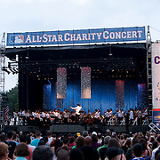 July 13, 2013 - New York, NY : <br /> The New York Philharmonic, lead by Alan Gilbert, center, perform in the free MLB All-Star Charity Concert to benefit Hurricane Sandy victims, in Central Park's great lawn on July 13, 2013. Pop star Mariah Carey (not pictured) made a guest appearance. <br /> CREDIT: Karsten Moran for The New York Times