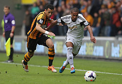 Swansea's Wayne Routledge beats Hull's Liam Rosenior for pace - Photo mandatory by-line: Matt Bunn/JMP - Tel: Mobile: 07966 386802 05/04/2014 - SPORT - FOOTBALL - KC Stadium - Hull - Hull City v Swansea City- Barclays Premiership