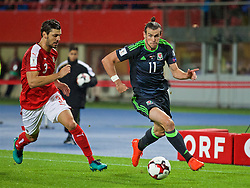 VIENNA, AUSTRIA - Thursday, October 6, 2016: Wales' Gareth Bale in action against Austria's Aleksandar Dragovic during the 2018 FIFA World Cup Qualifying Group D match at the Ernst-Happel-Stadion. (Pic by David Rawcliffe/Propaganda)