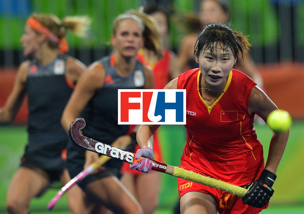 China's Sun Xiao chases the ball during the women's field hockey China vs Netherlands match of the Rio 2016 Olympics Games at the Olympic Hockey Centre in Rio de Janeiro on August, 10 2016. / AFP / Carl DE SOUZA        (Photo credit should read CARL DE SOUZA/AFP/Getty Images)