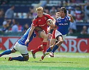 Canada captain John Moonlight breaks a Samoan tackle during the Hong Kong Sevens 2015 match between Canada  Sevens and Samoa  Sevens at the Hong Kong Stadium, Hong Kong on 28 March 2015. Photo by Ian Muir....during the Hong Kong Sevens 2015 match between ........... at Hong Kong Stadium, Hong Kong on 27 March 2015. Photo by Ian Muir.