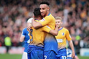 Mansfield Town defender Rhys Bennett (2) and Mansfield Town defender Malvind Benning (3) celebrate after the final whistle after the EFL Sky Bet League 2 match between Chesterfield and Mansfield Town at the Proact stadium, Chesterfield, England on 14 A pril 2018. Picture by Nigel Cole.