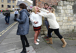 © Licensed to London News Pictures. 29/04/2017. Hartlepool UK. A fight breaks out between Pro EU campaigner North East for Europe (Right in black leggings) and a UKIP party supporter (centre, red skirt) in Hartlepool, County Durham, before UKIP leader Paul Nuttall heads out on the campaign trail. Photo credit: Andrew McCaren/LNP