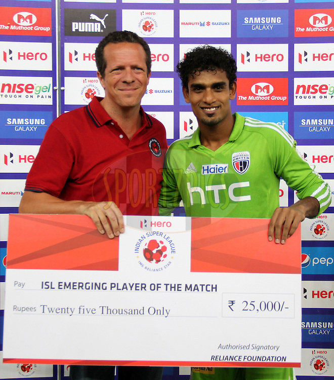 Rehenesh Thumbirumbu Paramba of NorthEast United FC receive the ISL Emerging Player of the match award during match 16 of the Hero Indian Super League between The Delhi Dynamos FC and NorthEast United FC held at the Jawaharlal Nehru Stadium, Delhi, India on the 29th October 2014.<br /> <br /> Photo by:  Deepak Malik/ ISL/ SPORTZPICS