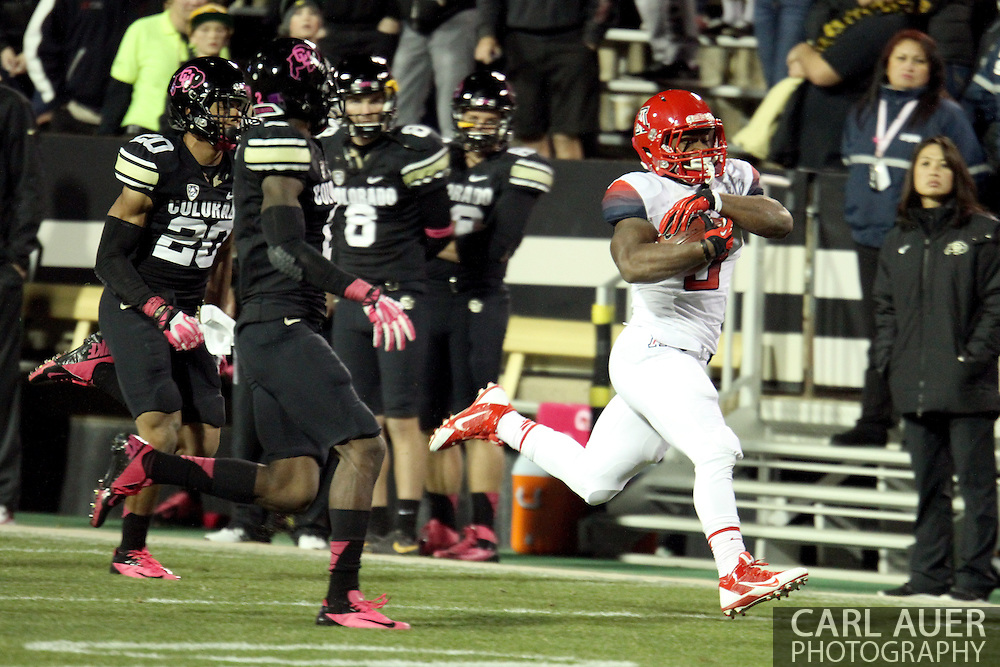 October 26th, 2013:  University of Arizona Wildcats freshman wide receiver Trey Griffey (5) runs a pass reception down the field for a large gain in the fourth quarter of the NCAA football game between the University of Arizona Wildcats and the University of Colorado Buffaloes at Folsom Field in Boulder, Colorado