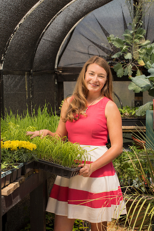 Brienne Gluvna is a leader in the foodscaping movement, emphasizing a balance of ornamentals and edibles for a visually appetizing result, pictured in her home garden in Fuquay-Varina, North Carolina, on Friday, April 8, 2016. <br /> Photo by D.L. Anderson for Ornamental Breeder Rice (Oryza sativa) marigolds (tagetes) <br /> Wheat (Triticum)