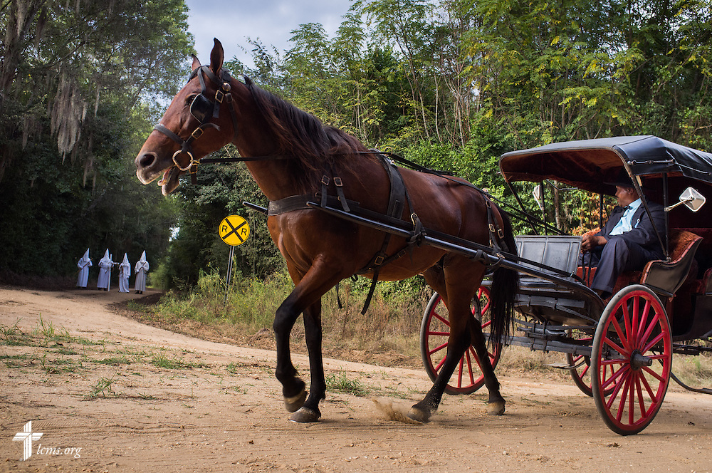 Driver Richard Smith guides his horse and buggy during a scene on the final day of filming for 'The First Rosa' documentary on Thursday, September 25, 2014, near Selma, Ala. LCMS Communications/Erik M. Lunsford