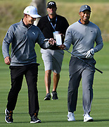 Bryson DeChambeau and Tiger Woods walk up the 17th fairway during a practice round. Woods returned to Riviera Country Club to get in a practice round before the Genesis Open. It is Woods first return to Riviera in a number of years. The tournament begins on Thursday. Pacific Palisades, CA 1/13/2018 (Photo by John McCoy)