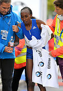 Gladys Cherono (KEN) is assisted after winning the women's race in 2:20.23 during the 44th Berlin Marathon in Berlin, Germany on Sunday, September 24, 2017. (Jiro Mochizuki/Image of Sport)
