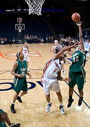 South Florida Bulls center Nalini Miller (32) shoots over Virginia Cavaliers Forward Lyndra Littles (1).  The Virginia Cavaliers defeated the South Florida Bulls 73-71 in the third round of the Women's NIT held at John Paul Jones Arena in Charlottesville, VA on March 22, 2007.