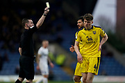 Rob Dickie of Oxford United receives a yellow card during the EFL Sky Bet League 1 match between Oxford United and Peterborough United at the Kassam Stadium, Oxford, England on 16 February 2019.