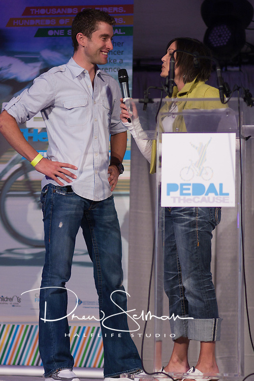 8-OCT-2010 -- ST LOUIS - Heidi Glaus, a reporter for KSDK television interviews pro-cyclist Christian Vande Velde at the kick off event for the inaugural Pedal the Cause cycling event.  Vande Velde rode on October 9th with the rest of the field.  Vande Velde currently rides with Team Garmin-Transitions and is the 2008 winner of the Tour of Missouri. Pedal the Cause is an annual cycling event that seeks to provide and direct net funding for cancer research, cancer discovery grants and clinical translational care on best ideas not currently eligible for federal funds.  With 100% of donations remaining in St. Louis, the event was started by Bill Koman, a St Louis business man and himself a cancer survivor.