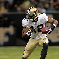 2009 August 14: New Orleans Saints wide receiver Marques Colston (12) runs after a catch during a preseason opener between the Cincinnati Bengals and the New Orleans Saints at the Louisiana Superdome in New Orleans, Louisiana.