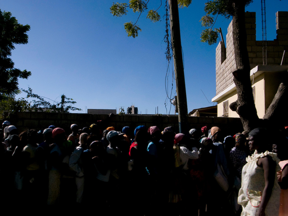 People wait in a food distribution line. Gonaives, Haiti. Photo by Ben Depp
