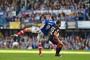 Portsmouth Forward, Oliver Hawkins (9) and Milton Keynes Dons Defender, Scott Golbourne (12) during the EFL Sky Bet League 1 match between Portsmouth and Milton Keynes Dons at Fratton Park, Portsmouth, England on 14 October 2017. Photo by Adam Rivers.