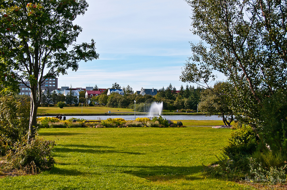 The Tjörnin, or the pond, is a lake in Reykjavik. It is popular with locals and water-birds. Geothermal waters keep part of the lake free of ice in the winter. The Pavilion Garden, in Reykjavik, Iceland, is on one side  of the famous Tjornin pond.