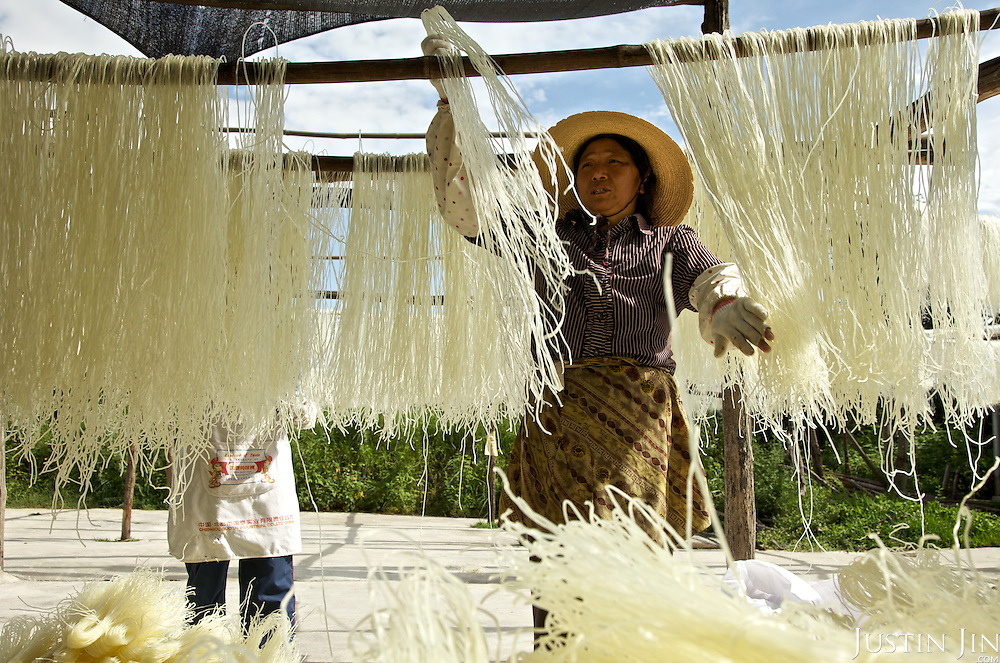 A woman makes noodles in a village outside Dali, Yunnan province, southwestern China.