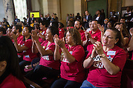 Supporters cheer and applause as the Los Angeles City Council votes to raise the minimum wage $15 per hour by 2020, in Los Angeles, California, on Tuesday, May 19, 2015. The council voted 14-1 in favor of raising the minimum wage. Under the plan, the wage will increase incrementally beginning in July 2016, eventually reaching $15 an hour by 2020 for employers with 26 or more workers, with a one- year delay for smaller businesses.(Photo by Ringo Chiu/PHOTOFORMULA.com)