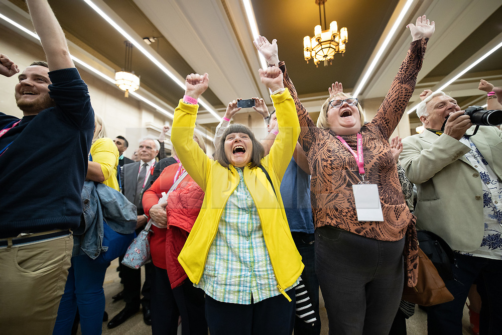 © Licensed to London News Pictures . 02/05/2019. Bolton, UK. Farnworth and Kearsley First independent party supporters cheer their candidate Paul Heslop's win in Kearsley . The count for Bolton Council at Bolton Town Hall . The Labour Party are threatened to lose their majority on the council . Local council elections are taking place across the country . Photo credit: Joel Goodman/LNP